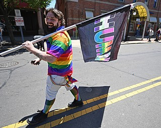 WARREN, OHIO - JUNE 22, 2019: Shane Glaeser smiles while marching during the Pride parade around Courthouse square, Saturday afternoon during the Pride Festival. DAVID DERMER   THE VINDICATOR