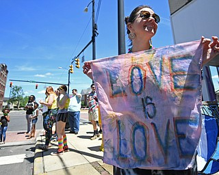 WARREN, OHIO - JUNE 22, 2019: Kelly Mimna, of Warren, stands near the parade route around Courthouse square, Saturday afternoon during the Pride Festival. DAVID DERMER   THE VINDICATOR