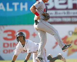 Scrappers' Brayan Rocchio slides into second as Doubledays' J.T. Arruda tries to get to the bag during their game at Eastwood Field on Sunday. EMILY MATTHEWS | THE VINDICATOR