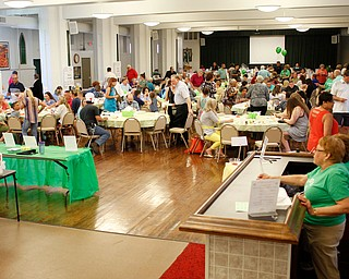 People try food from 24 different cooks during Taste of St. Patrick's at St. Patrick Church of Youngstown on Sunday. EMILY MATTHEWS | THE VINDICATOR