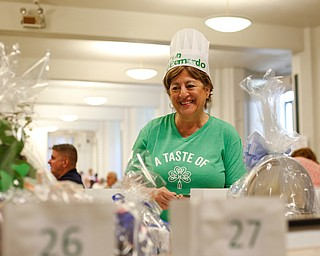 Roseann DiBernardo, of Youngstown, puts tickets into a raffle basket drawing during Taste of St. Patrick's at St. Patrick Church of Youngstown on Sunday. EMILY MATTHEWS | THE VINDICATOR