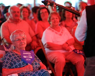 Joyce Franklin, of Brookfield, listens to music played by Bill Lewis at Warren Chautauqua on Tuesday evening. Franklin says she tries to go to the Chautauqua events whenever she can and travels to other areas to see them when they are not held in Warren. EMILY MATTHEWS | THE VINDICATOR