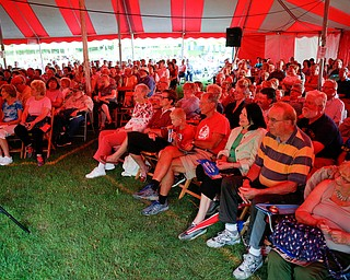 People watch and listen to Susan Marie Frontczak give a presentation as Erma Bombeck at Warren Chautauqua on Tuesday evening. EMILY MATTHEWS | THE VINDICATOR