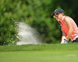 BOARDMAN, OHIO - JUNE 25, 2019: Leah Benson, of Hermitage, chips out of the bunker on the 17th hole, Tuesday afternoon during the Vindy Greatest Golfer Qualifier at Mill Creek Golf Course. DAVID DERMER | THE VINDICATOR