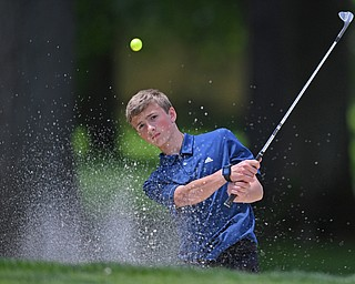 BOARDMAN, OHIO - JUNE 25, 2019: Caleb Domitrovich, of McDonald, chips out of the bunker on the 17th hole, Tuesday afternoon during the Vindy Greatest Golfer Qualifier at Mill Creek Golf Course. DAVID DERMER | THE VINDICATOR