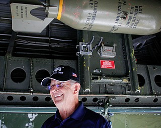 Curtis Wester, with the Commemorative Air Force, gives a tour and answers questions under a B-29 at the Warren Regional Airport on Wednesday. The B-29 and an AT6 were at the airport for people to look at and learn about. EMILY MATTHEWS | THE VINDICATOR