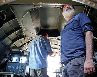 Shawn Smith, right, of Cincinnati, and Mark Fontanarosa look at the inside of a B-29 at the Warren Regional Airport on Wednesday. The B-29 and an AT6 were at the airport for people to look at and learn about. EMILY MATTHEWS | THE VINDICATOR
