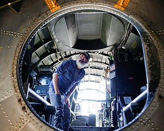 Shawn Smith, of Cincinnati, looks at the inside of a B-29 at the Warren Regional Airport on Wednesday. The B-29 and an AT6 were at the airport for people to look at and learn about. EMILY MATTHEWS | THE VINDICATOR
