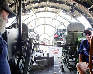 Scott Gupton, right, with the Commemorative Air Force, talks with Shawn Smith, left, of Cincinnati, about the B-29 they're sitting in at the Warren Regional Airport on Wednesday. The B-29 and an AT6 were at the airport for people to look at and learn about. EMILY MATTHEWS | THE VINDICATOR