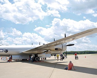 People look at a B-29 at the Warren Regional Airport on Wednesday. The B-29 and an AT6 were at the airport for people to look at and learn about. EMILY MATTHEWS | THE VINDICATOR