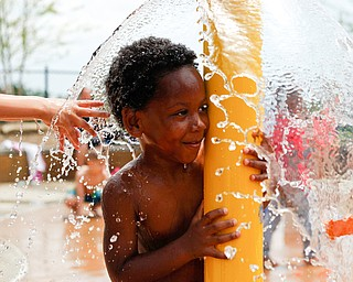 Mason Moore, 6, who attends Daycare Storybook, plays under the water at the water park in the James L. Wick, Jr. Recreation Area in Mill Creek Park on Thursday. The daycare went to the park today to cool off and enjoy the weather. EMILY MATTHEWS   THE VINDICATOR