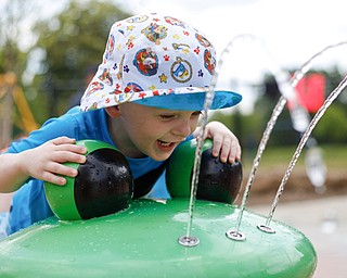 Silas Turner, 2, of Warren, plays with water at the water park in the James L. Wick, Jr. Recreation Area in Mill Creek Park on Thursday. EMILY MATTHEWS   THE VINDICATOR