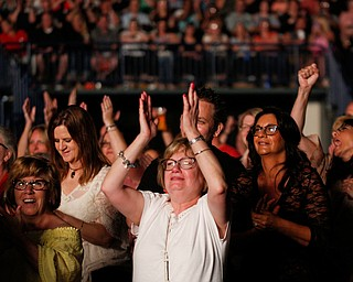 People in the crowd cheer as Lionel Richie performs at Covelli Centre on Saturday night as part of his Hello Tour. EMILY MATTHEWS | THE VINDICATOR