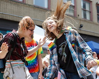 Ely Kendall, 15, of Boardman, left, and Avery Hodgson, 14, of Trevor, Wisconsin, dance at the 11th annual Pride parade and festival in downtown Youngstown on Saturday afternoon. EMILY MATTHEWS   THE VINDICATOR