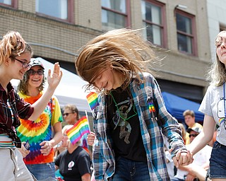From left, Ely Kendall, 15, of Boardman, Jay Quen, 13, of Springfield, Avery Hodgson, 14, of Trevor, Wisconsin, and Georgia Kirkbride, 13, of Indianapolis, Indiana, dance at the 11th annual Pride parade and festival in downtown Youngstown on Saturday afternoon. EMILY MATTHEWS   THE VINDICATOR