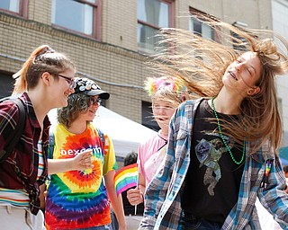From left, Ely Kendall, 15, of Boardman, Jay Quen, 13, of Springfield, Zofia Rumbalski, 13, of Youngstown, and Avery Hodgson, 14, of Trevor, Wisconsin, dance at the 11th annual Pride parade and festival in downtown Youngstown on Saturday afternoon. EMILY MATTHEWS   THE VINDICATOR