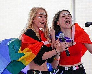 Tina Collins, left, and Katelyn Maniscalco, both of Youngstown, sing Lizzo's Truth Hurts during a karaoke competition at the 11th annual Pride parade and festival in downtown Youngstown on Saturday afternoon. EMILY MATTHEWS   THE VINDICATOR