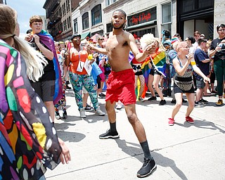 Louis Brown, of Youngstown, dances with the crowd at the 11th annual Pride parade and festival in downtown Youngstown on Saturday afternoon. EMILY MATTHEWS   THE VINDICATOR