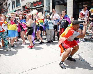 Teaunia Jenkins, of Youngstown, dances with the crowd at the 11th annual Pride parade and festival in downtown Youngstown on Saturday afternoon. EMILY MATTHEWS   THE VINDICATOR