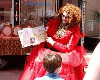 Esther Gin, a performer from Alliance, reads A Day in the Life of Marlon Bundo by Jill Twiss at the 11th annual Pride parade and festival in downtown Youngstown on Saturday afternoon. EMILY MATTHEWS   THE VINDICATOR