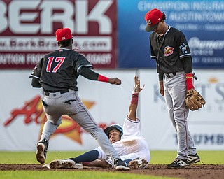 DIANNA OATRIDGE   THE VINDICATOR Mahoning Valley's Brayan Rocchio looks for the call after sliding into second base after Batavia's Dalvy Rosario (17) makes the tag and Gerardo Nunez (2) look on during their game at Eastwood Field on Saturday night.