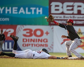 DIANNA OATRIDGE   THE VINDICATOR Mahoning Valley's Raynel Delgado (15) slides back to second base on a pick off attempt as Batavia's Gerardo Nunez makes the catch during their game at Eastwood Field on Saturday night.