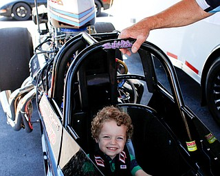 """Robert """"Obie"""" Alden, 4, of Niles, sits in PDRA world champion Tom Martino's Top Dragster at the Mahoning Valley Corvette Club's 25th Annual Corvette and Steel Car Show at Greenwood Chevrolet in Austintown on Sunday. EMILY MATTHEWS   THE VINDICATOR"""