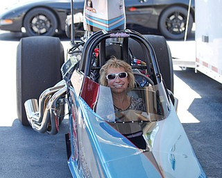 Sandy Russell, of Boardman, sits in PDRA world champion Tom Martino's Top Dragster at the Mahoning Valley Corvette Club's 25th Annual Corvette and Steel Car Show at Greenwood Chevrolet in Austintown on Sunday. EMILY MATTHEWS   THE VINDICATOR