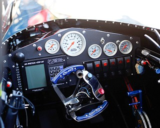 The inside of PDRA world champion Tom Martino's Top Dragster includes buttons, a computerized system, gears, and parachute release levers, which could be seen at the Mahoning Valley Corvette Club's 25th Annual Corvette and Steel Car Show at Greenwood Chevrolet in Austintown on Sunday. EMILY MATTHEWS   THE VINDICATOR