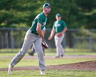 The Stark County Terriers' Aaron Miller reacts after over-throwing the ball to first during their game against the Astro Falcons at Bob Cene Park on Sunday. EMILY MATTHEWS | THE VINDICATOR