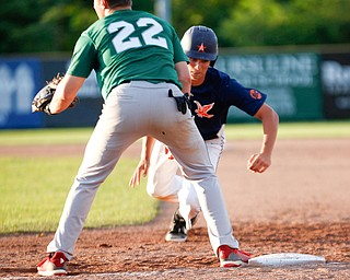 The Astro Falcons' Lucas Gulczynski runs back to first before the Stark County Terriers' Dalton Frey could tag him during their game at Bob Cene Park on Sunday. EMILY MATTHEWS | THE VINDICATOR