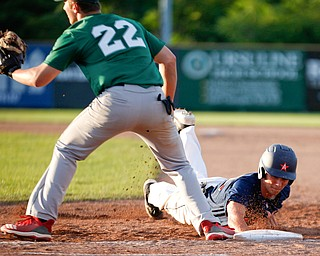 The Astro Falcons' Lucas Gulczynski dives back to first before the Stark County Terriers' Dalton Frey could tag him during their game at Bob Cene Park on Sunday. EMILY MATTHEWS | THE VINDICATOR