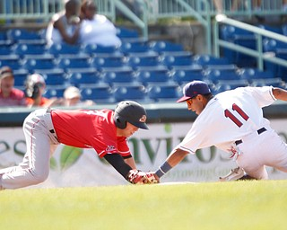 Scrappers' Brayan Rocchio tries to tag Muckdogs' Kobie Taylor out at third during their game at Eastwood Field on Sunday afternoon. EMILY MATTHEWS | THE VINDICATOR