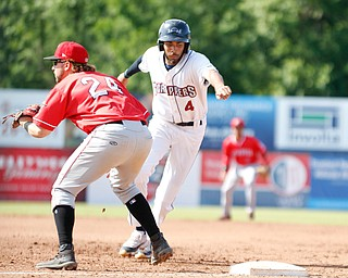 Scrappers' Michael Cooper runs back to first before Muckdogs' Harrison Dinicola could tag him during their game against the Muckdogs at Eastwood Field on Sunday afternoon. EMILY MATTHEWS | THE VINDICATOR