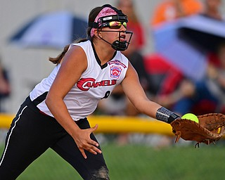 BOARDMAN, OHIO - JULY 2, 2019: Canfield's Katie Kouliaanos catches a fly ball for the out in the second inning of their game, Tuesday night against Boardman at the Field of Dreams. Boardman's Sophia Rivera would be out on the play. Canfield won 6-1. DAVID DERMER | THE VINDICATOR