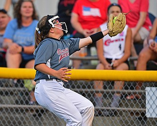 BOARDMAN, OHIO - JULY 2, 2019: Boardman's Olivia LaCivita catches a fly ball for the out in foul territory in the second inning of their game, Tuesday night against Boardman at the Field of Dreams. Canfield's Marina Koenig would be out on the play. Canfield won 6-1. DAVID DERMER | THE VINDICATOR