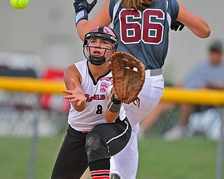 BOARDMAN, OHIO - JULY 2, 2019: Canfield's Katie Koulianos looks the ball into her glove after a infield RBI single by Boardman's Lilly Ditz in the third inning of their game, Tuesday night against Boardman at the Field of Dreams. Canfield won 6-1. DAVID DERMER | THE VINDICATOR