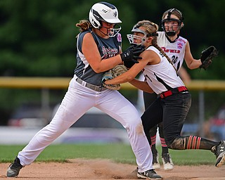 BOARDMAN, OHIO - JULY 2, 2019: Canfield's Katie Koulianos, left, is tagged out by Canfield's Caley Salley after attempting to steal second base in the third inning of their game, Tuesday night against Boardman at the Field of Dreams. Canfield won 6-1. DAVID DERMER | THE VINDICATOR