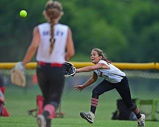 BOARDMAN, OHIO - JULY 2, 2019: Canfield's Sydney Lutz dives in an unsuccessful attempt to cath a ball hit by Boardman's Alex Ward in the fifth inning of their game, Tuesday night against Boardman at the Field of Dreams. Canfield won 6-1. DAVID DERMER | THE VINDICATOR
