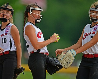 BOARDMAN, OHIO - JULY 2, 2019: Canfield's Paris Lindgren, center, is congratulated by Caley Selley, right, and Sami Economos, left, after an out in the fifth inning of their game, Tuesday night against Boardman at the Field of Dreams. Canfield won 6-1. DAVID DERMER | THE VINDICATOR