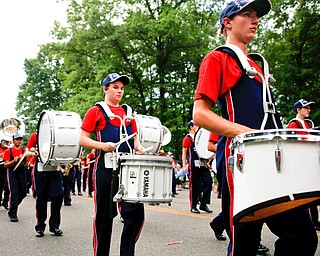 Members of the Austintown Fitch Marching Band play and march in the Austintown Fourth of July parade on Raccoon Road Thursday afternoon. EMILY MATTHEWS | THE VINDICATOR
