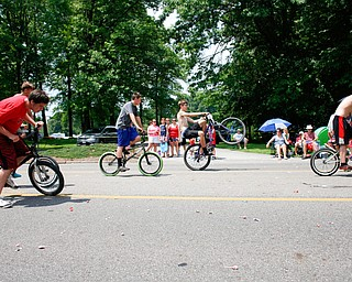 Bicyclists ride in the Austintown Fourth of July parade on Raccoon Road Thursday afternoon. EMILY MATTHEWS | THE VINDICATOR