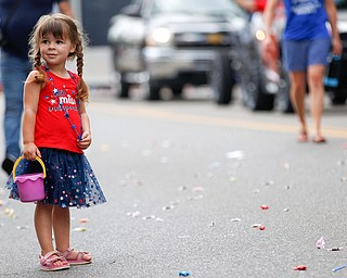 Kendal Kane, 2, of Austintown, watches the Austintown Fourth of July parade on Raccoon Road Thursday afternoon. EMILY MATTHEWS | THE VINDICATOR