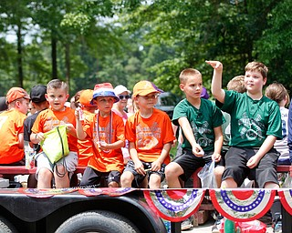 Kids with Austintown Community Baseball toss candy during the Austintown Fourth of July parade on Raccoon Road Thursday afternoon. EMILY MATTHEWS | THE VINDICATOR