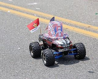 A remote control car zooms down the street with Motor Maffia Motorsports during the Austintown Fourth of July parade on Raccoon Road Thursday afternoon. EMILY MATTHEWS | THE VINDICATOR