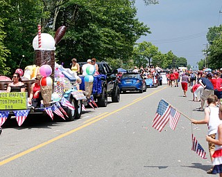 People watch as the Austintown Fourth of July parade makes its way down Raccoon Road Thursday afternoon. EMILY MATTHEWS | THE VINDICATOR
