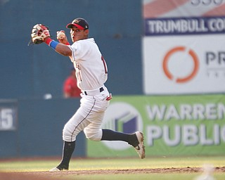 Scrappers' Brayan Rocchio prepares to throw the ball to first during their game against the Spikes at Eastwood Field on Thursday. EMILY MATTHEWS | THE VINDICATOR