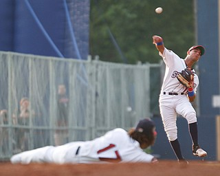 Scrappers' Brayan Rocchio throws the ball over Henderson De Oleo during their game against the Spikes at Eastwood Field on Thursday. EMILY MATTHEWS | THE VINDICATOR
