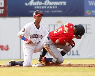 The ball gets past Scrappers' Brayan Rocchio as the Spikes' Donivan Williams makes it safely to second during their game at Eastwood Field on Thursday. EMILY MATTHEWS | THE VINDICATOR
