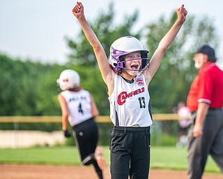 DIANNA OATRIDGE | THE VINDICATOR  Canfield's Brooke Opalick (13) reacts  as her teammate Riley Billack (4) runs the bases after hitting a home run against Howland during the 10U tournament in Boardman on Friday.
